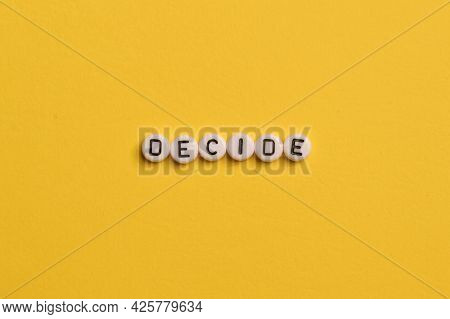 Alphabet Letters With Text Decide Isolated On Yellow Background