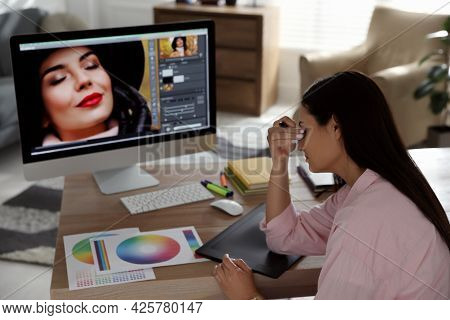 Tired Retoucher At Workplace With Computer In Office