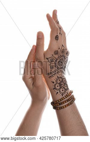 Woman With Beautiful Henna Tattoo On Hand Against White Background, Closeup. Traditional Mehndi