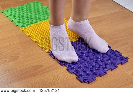 Orthopedic Mats For The Prevention Of Flat Feet. Women\\\'s Feet Standing On An Orthopedic Mat. Feet