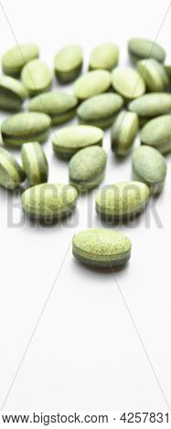 Green Oval Tablet Pills Isolated On White Background, Medical Oval Pills Tablets
