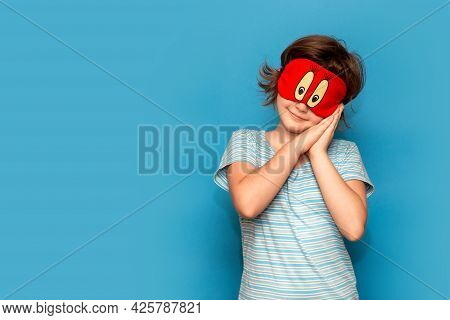 Portrait Of Happy Little Girl Sleep Or Wake Up In Morning Isolated On Blue Background. Smiling Child