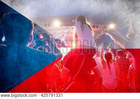 Football fans supporting Czech Republic- crowd celebrating in stadium with raised hands against Czech Republic flag
