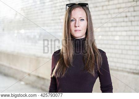 Fashion portrait of attractive trendy thin woman outdoor. Street fashion.
