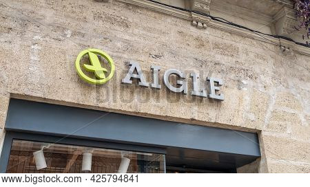 Montpellier , Ocitanie France  - 06 30 2021 : Aigle Sign Text And Logo Brand Of Store French Shoes F