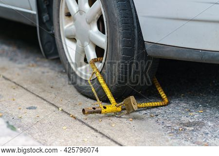 Locked Wheel Of A Car Parked In An Improper Place, Because  Illegal Parking Violation