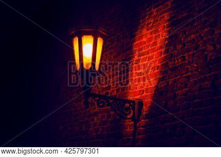 Medieval Street Light Illumination . Street Lamp And Brick Wall . Illumination In Old Town