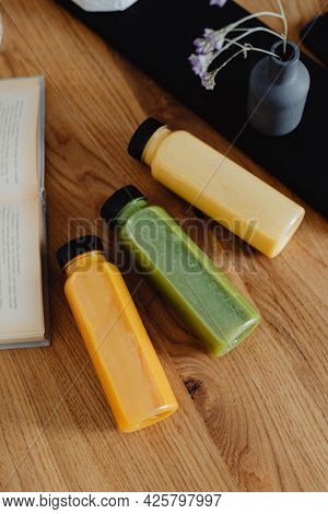 Homemade freshly squeezed juice in bottles on a table
