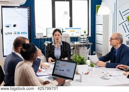Group Of Diverse Business People Having A Meeting In Conference Room. Businesswoman Discussing Ideas