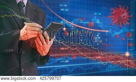 Businessman Use Mobile Phone To Analysis Stock Market  Graph Due Coronavirus Or Covid-19 Crisis. Bus