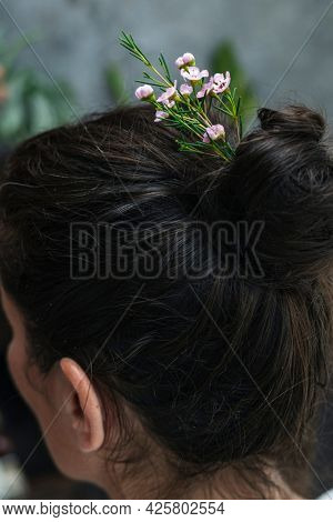 Brunette with flowers in her hair