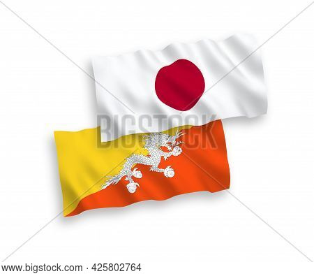 National Fabric Wave Flags Of Japan And Kingdom Of Bhutan Isolated On White Background. 1 To 2 Propo