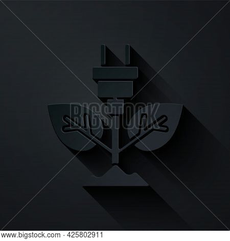 Paper Cut Electric Saving Plug In Leaf Icon Isolated On Black Background. Save Energy Electricity. E
