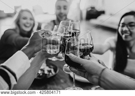 Friends making a toast at a dinner party