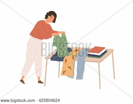 Woman Folding Used Clothes, Selecting Them For Charity And Preparing For Sale. Person Choosing Garme