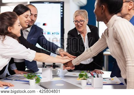 Cheerful Overjoyed Business People In Conference Room Celerating Diverse Colleagues With New Opportu