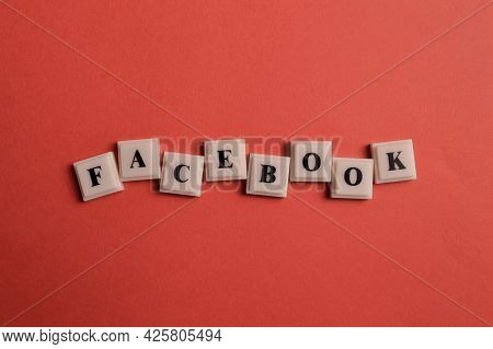 Klang, Malaysia: July 5, 2021- Square Letters With Text Facebook Isolated On Red Background
