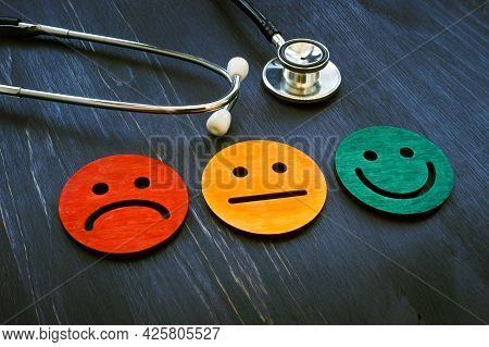 Patient Experience Concept. Stethoscope And Smiled Faces For Hospital Consumer Assessment.