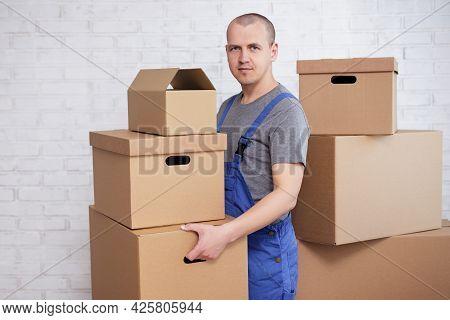 Handsome Man Loader Or Deliveryman Holding Many Boxes