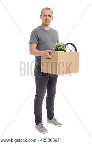 Portrait Of Young Man Holding Box With Belongings Isolated On White Background
