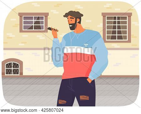 Happy Man With Headphones Is Looking At His Smartphone. Guy Listens To Music While Walking. Person I
