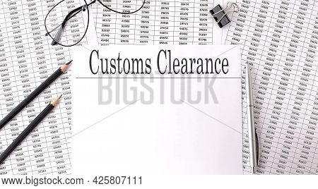 Paper With Customs Clearance On A Table On Charts