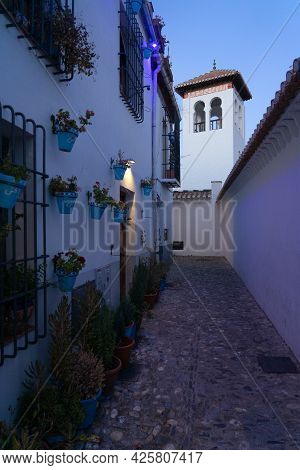 Typical White Streets In The Historic Neighborhood Of Albaicin In The City Of Granada At Night. Anda