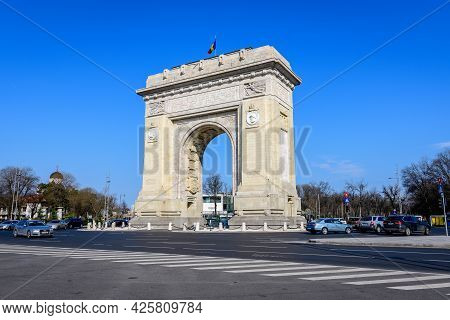 Bucharest, Romania, 3 April 2021: Arcul De Triumf (the Arch Of Triumph) Is A Triumphal Arch And Land
