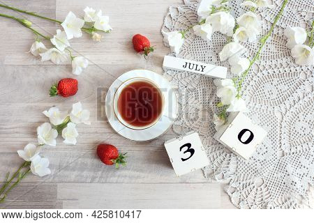 Calendar For July 30 : Cubes With The Number 30, The Name Of The Month Of July In English, A Cup Of