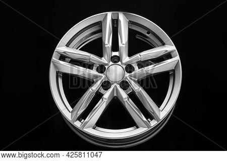 Silver Alloy Wheel With Bifurcated Beams On A Black Background