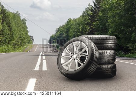 Summer Tires And Alloy Wheels Set On An Asphalt Road. Tire Change Season, Auto Trade, Copy Space , A