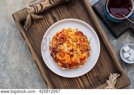 Unsweetened Pies Or Mini Tart With Egg, Chicken, Bell Pepper And Cheese On A Ceramic Plate On A Wood