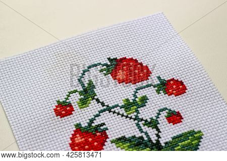 Red Ripe Strawberries Embroidered With A Cross-stich On A White Canvas By Hand. Close Up, Macro.