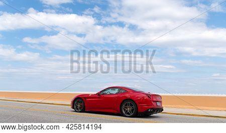 Palm Beach, Florida Usa - March 21, 2021: Red Ferrari California Luxury Car On Road In Palm Beach