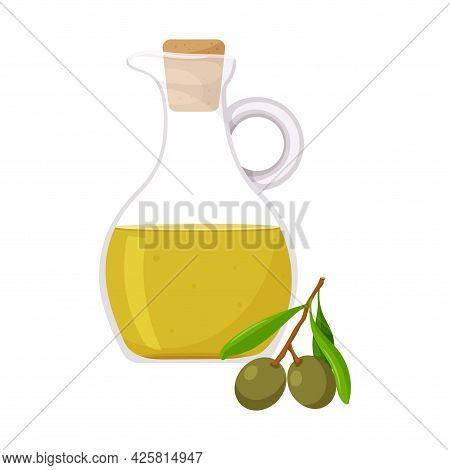 Olive Oil In A Jug. And A Branch Of An Olive Tree With Green Olives. Healthy Food, An Ingredient. Fl