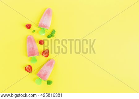 Flat Lay With Fruity Pink Frozen Sorbet Ice-cream On Green Plastic Stick Collection With Cuts Of Str