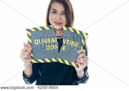 Woman Shows And Tearing Paper With Covid-19 Quarantine Zone Warning Words. The Idea Or Concept For T