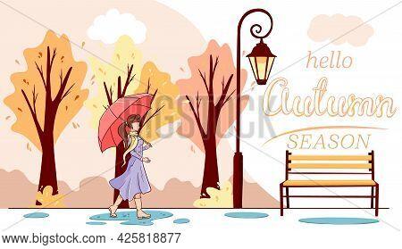 Hello Autumn Banner. A Girl With An Umbrella Walks Through The Autumn Park.