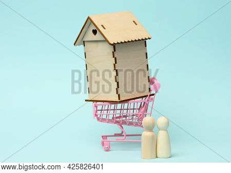 Wooden Family Figurines, Model House. Real Estate Purchase, Rental Concept. Moving To New Apartments