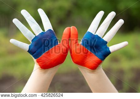 Child Show Hands Painted In Russia Flag Colors Walking Outdoor. Day Of Russian Flag. Patriots Patrio