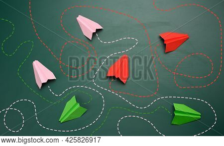 Group Of Paper Planes With Long Tangled Paths On A Green Background. Concept Of A Strong Leader With