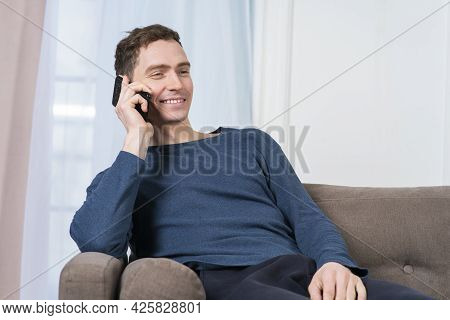 Portrait Of Happy Positive Guy, Young Cheerful Man Is Chatting, Talking On Cell Mobile Phone, Having