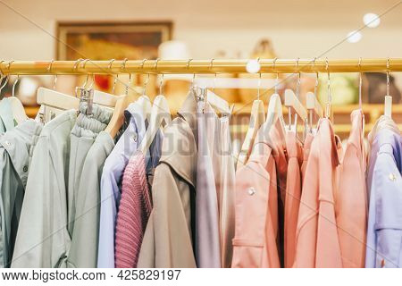 Multicolored Youth Clothes On Hanger For Sale In Shop, Assortment In Clothing Store