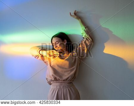 Neon Light Woman. Positive Lifestyle. Carefree Joy. Happy Youth. Cheerful Smiling Girl Relaxing Enjo