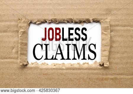Jobless Claims. Text On Torn Paper. Test In Black Letters