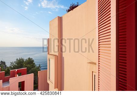 Geometric Red Building. The Red Wall, La Manzanera. Calpe, Spain