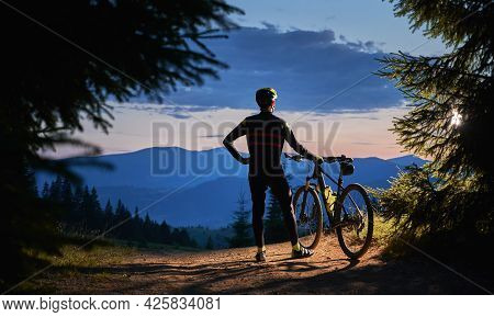 Back View On Male Cyclist Standing Holding His Bike, Watching Beautiful Landscape, Mountains Peaks A