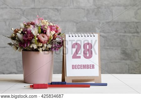 December 28. 28-th Day Of The Month, Calendar Date.a Delicate Bouquet Of Flowers In A Pink Vase, Two