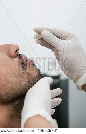 Coronavirus Test - Close Up Of Medical Worker Taking Rapid Nose Swab For Corona Virus Sample From Yo