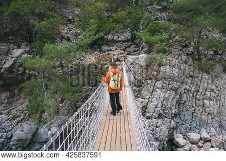 A Girl With A Backpack Walks On A Suspension Bridge, Sights Of Turkey, Travel Through Scenic Places,